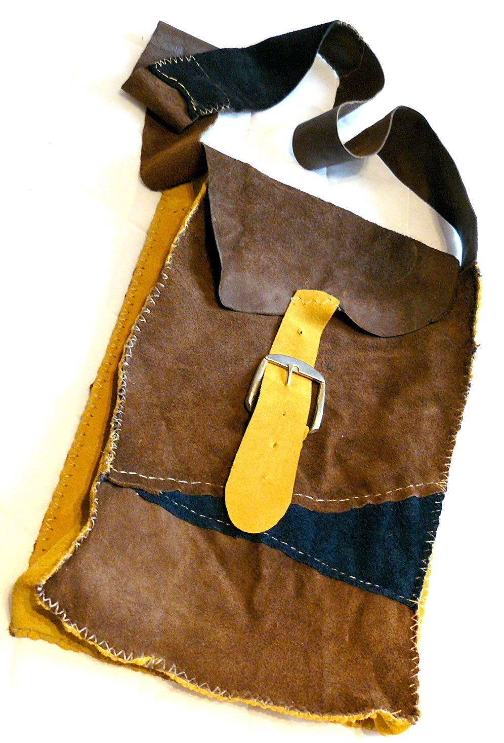 leather bag hand-stitched from upholstery leather scraps.