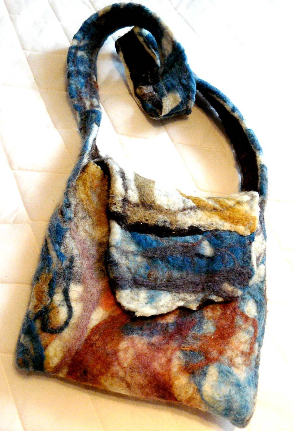 wet/needle felted bag, with needle felted pocket and cotton lining.