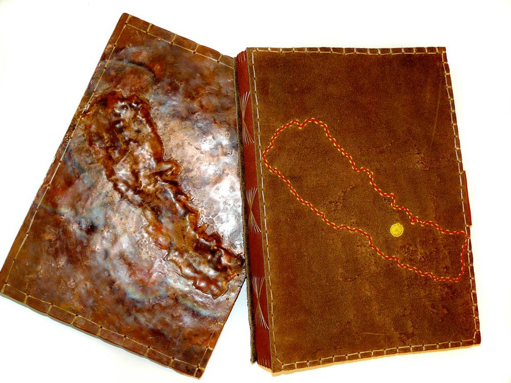 handmade bindings created in collaboration with artist Rob Fairley for his original bookwork - embroidered leather and reppousé'd copper.