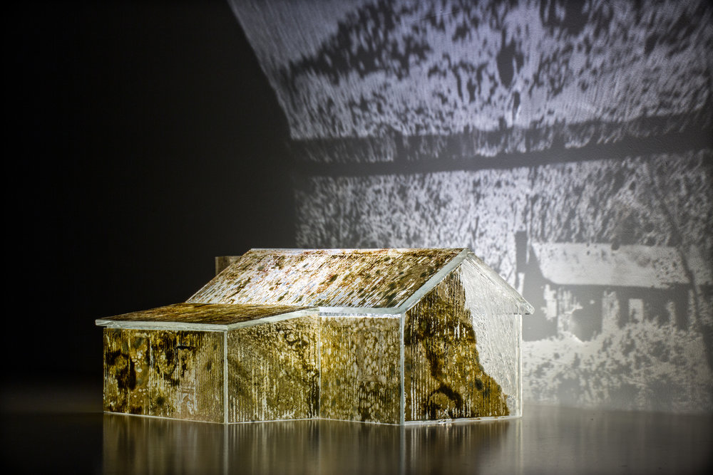 White River Hut H19cm x L31cm x W23cm blown and kiln formed glass w glass powder & metal leaf surfaces and sandblasted landscape imagery.jpg