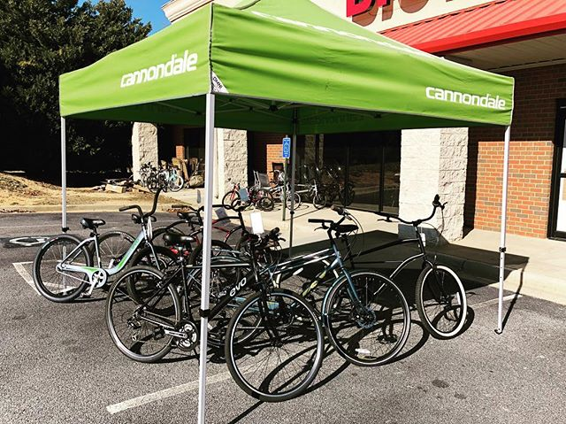 Come see what's under the green tent! #evans #bicycles #saturday
