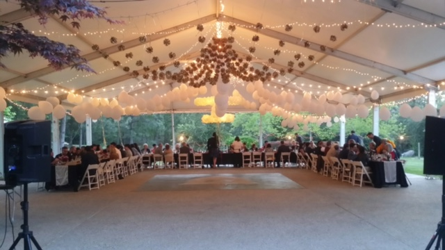 The reception tent filled with friends, family, and delicious food!