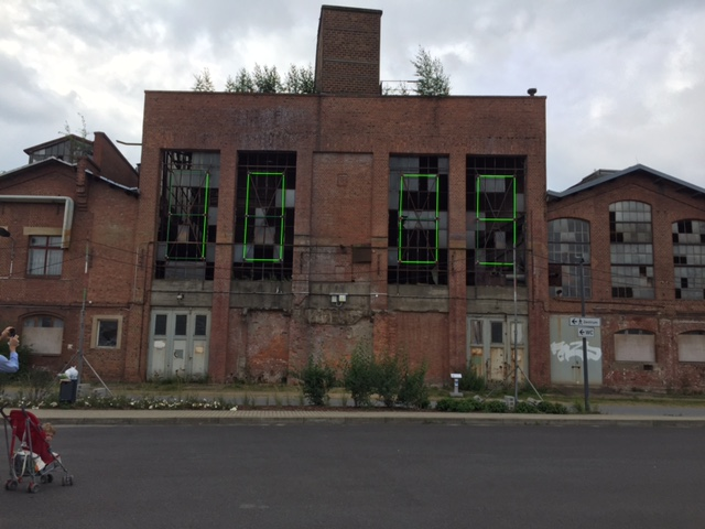 """""""Clock,"""" electronic time-keeper attached to abandoned factory building, technology continues to change the world around us."""