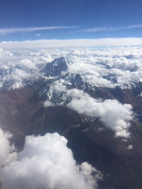 Flying into Cusco, Peru with mountain peaks over 18,000'