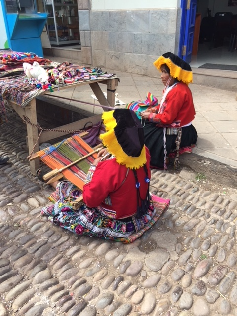 Weavers in Pisac. Clothing is similar to what was worn hundreds of years ago and unique to each tribe.