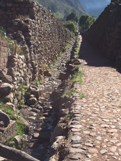 Ancient water canals still in use for farming and irrigation.