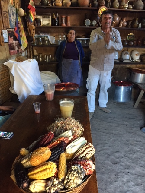 Our guide and the corn beer maker, with ingredients.