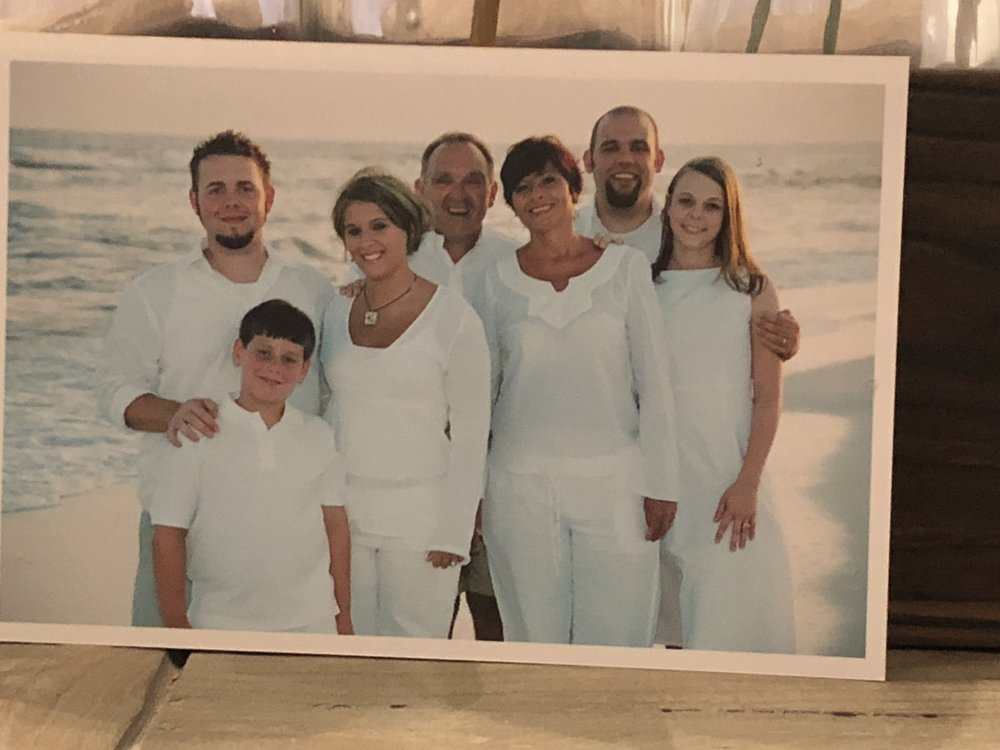 Our family at the beach in 2005. Dad was determined to get these pictures taken even though there was a hurricane coming through Destin in just a few hours. We had to evacuate at 10 p.m. and drove all night to get home. But now I am so glad he was determined to have us do it.