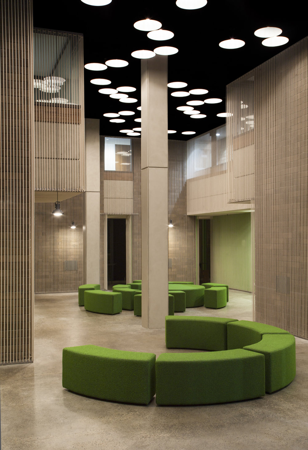 THE WINE QUARTER      This fit-out for Endeavour Drinks Group creates a new multipurpose events space for 500 staff  within a heritage-listed building in Surry Hills that was originally designed for Readers Digest. The project makes explicit the idea of the interior  fit-out as distinct and separable from the architecture, in recognition of the fact that tenants and functions will change over time. Previous additions were removed and the heritage brickwork was carefully restored. A lightweight, tensioned cotton cord lining is then introduced to wrap the heritage interior, 'monumentalising' the architecture by emphasising its volumetric features, while lightening the whole space, improving acoustics and screening  first floor office windows. This permeable veil allows views through to the heritage brickwork and detailing, and provides partial concealment of services such as air conditioning, lighting, alarms and sprinklers, while allowing them to operate through it.      Year:   2016   Location:   Surry Hills, NSW   Photography:   Peter Bennetts, Kasia Werstak