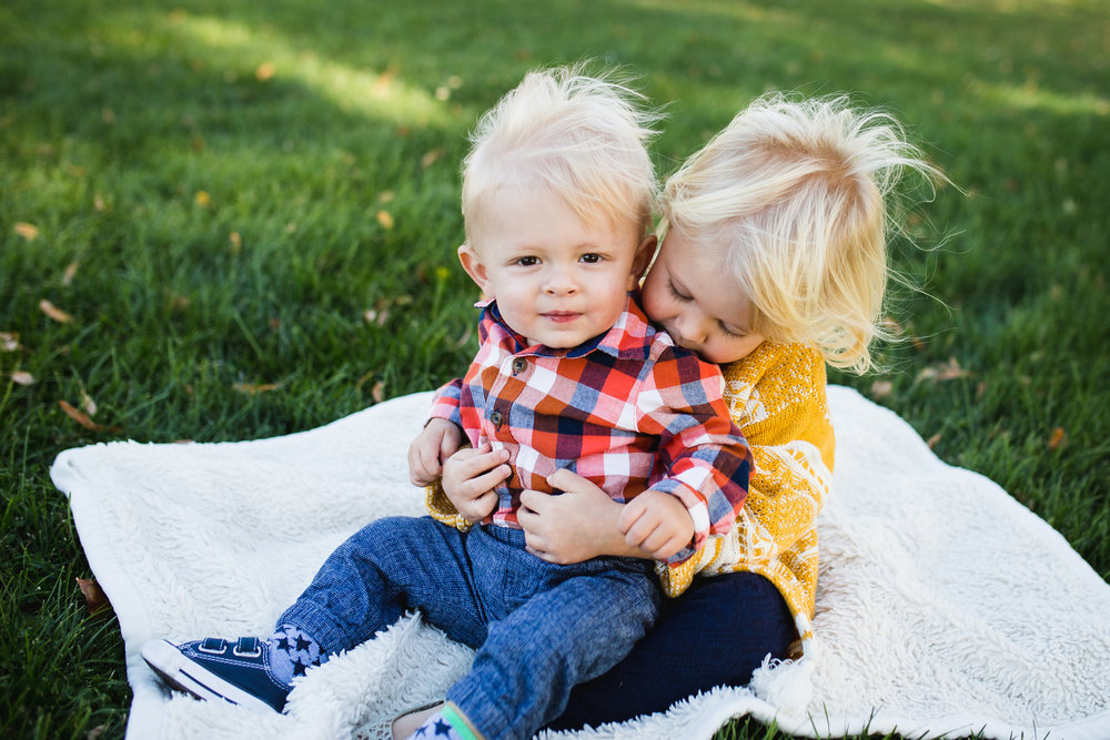 Lifestyle photo of toddler siblings by Lily Jean Photography