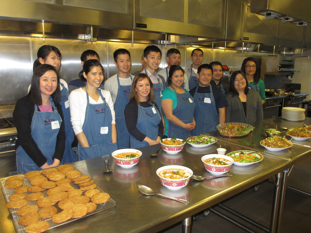 2015 Portland participants learn team-building skills by preparing a meal together.