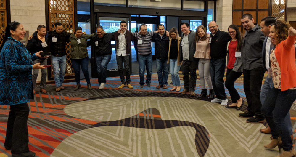 The Mi Gente team gathers together for a dancing energizer in Bellevue!
