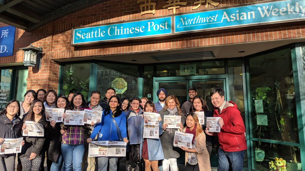 The AWA team poses with Assunta Ng of the NW Asian Weekly before they're lead around the International District learning about the community and its' history.