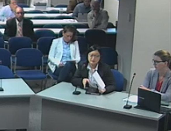 Anna Kim (center) presents to the Commission while accompanied by her lawyer as her manager observes from the audience.   Puget Sound Discovery, Class of 2018