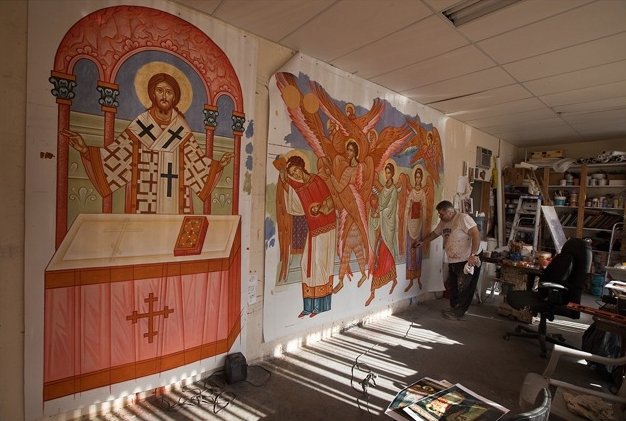 Fr. Theodore paints in studio