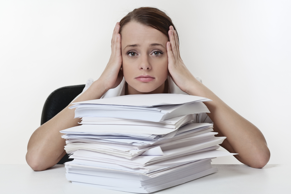 Woman with Stack of Papers.jpg