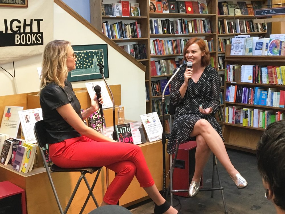speaking at a book signing event for 'backwards & in heels'