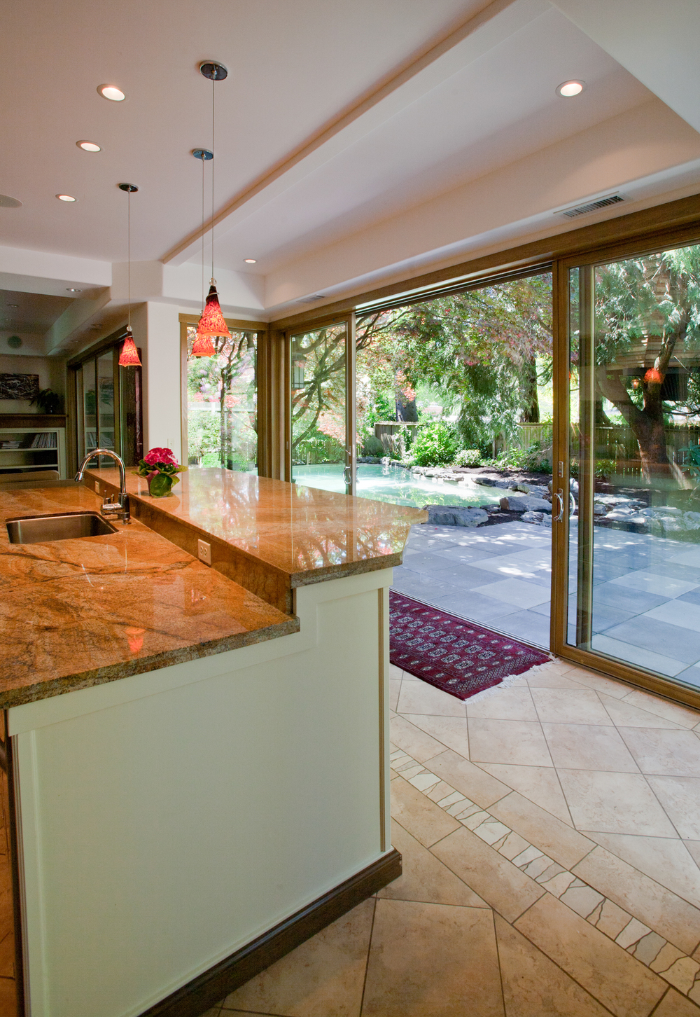 A view of the pool from inside the kitchen through the glass walls.