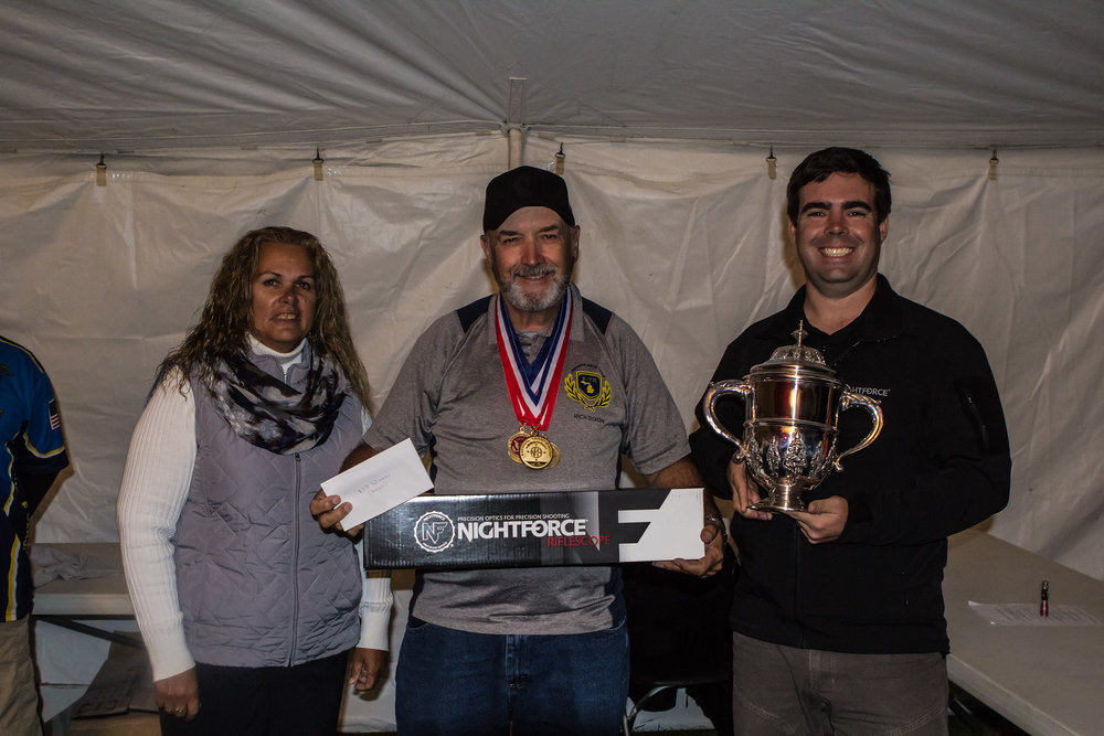 Richard Dixon (c) 2016 National Champion. Presented by Sheri Judd (l) of the NRA and Sean Murphy (r) of Nightforce Optics.