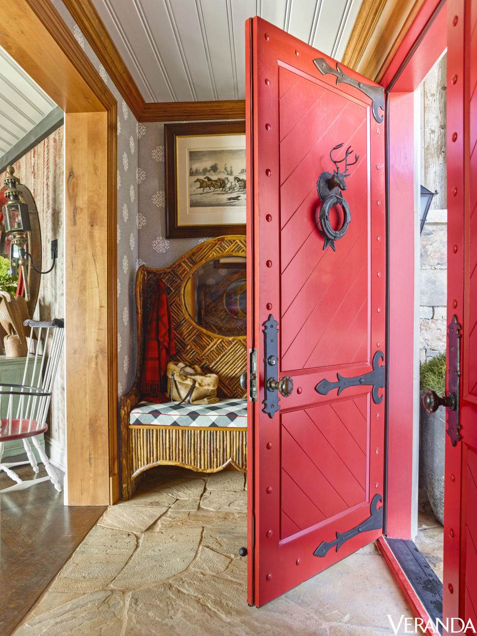 A detailed red door with a stage and wreath knocker sets the stage. This is NOT your typical sterile modern mega ski house. & Mad for Plaid Holiday Ski House \u2014 The Foo Dog Blog