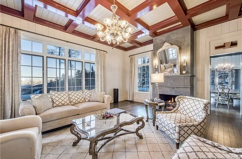 Vertical Boards Also Envelop The Living Room. White Walls And Mahogany  Coffered Ceiling Beams Read As Warm And Fluffy, Not Cold And Stark.