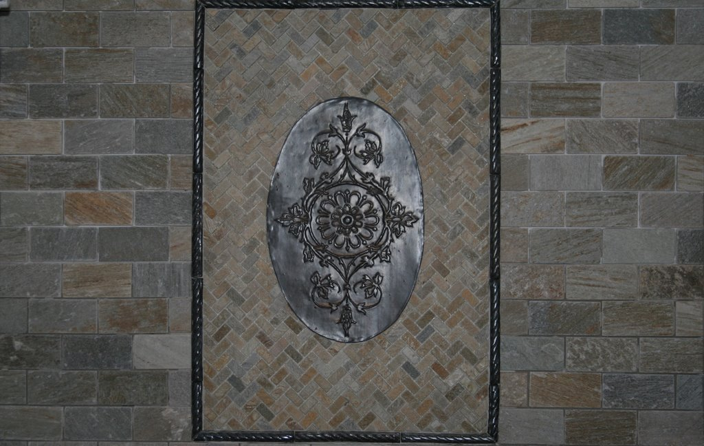 Concordia in Metallic Black glaze, stone mosaic tile, and Rope Molding frame.