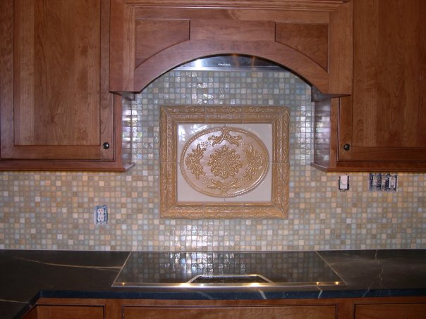 Aurelia with Kallisto frame (Old Gold), Satin White custom-sized surround and glass mosaic background tiles