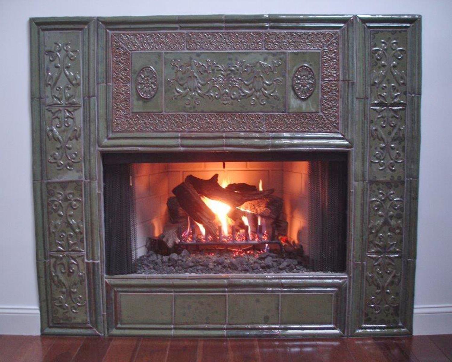 Completed and installed Fireplace in Green Shadow Glaze
