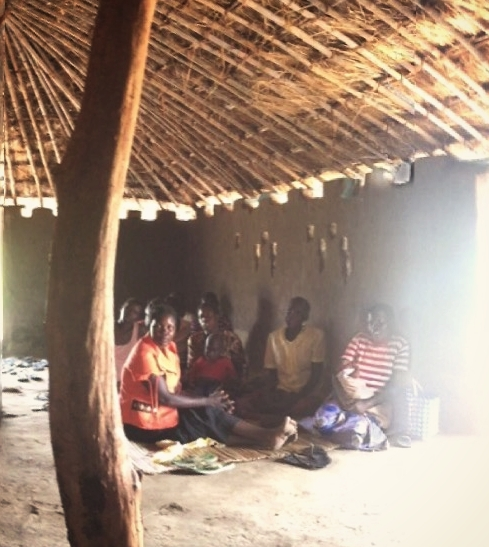 A group of mom's huddled together in Gulu, Uganda.