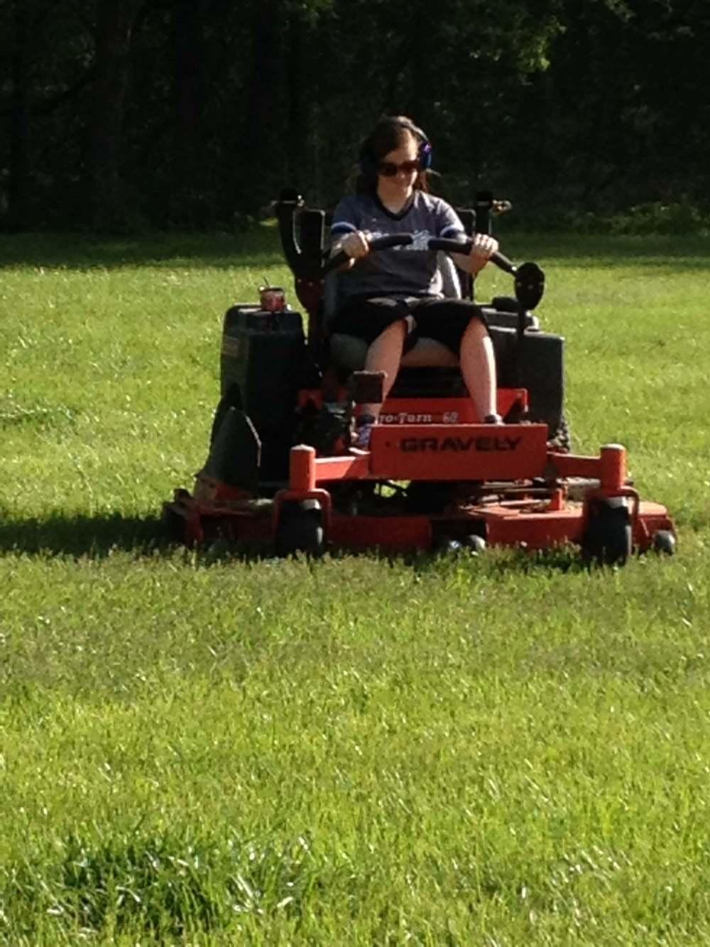 Megan mowing