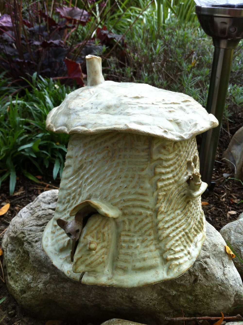 Maybe you want to give the fairies a place of their own in your garden?  Or maybe just something that will delight the kids' imaginations – fairy houses make a fanciful addition to any garden.  This pottery fairy house was created by Marcia Barron.