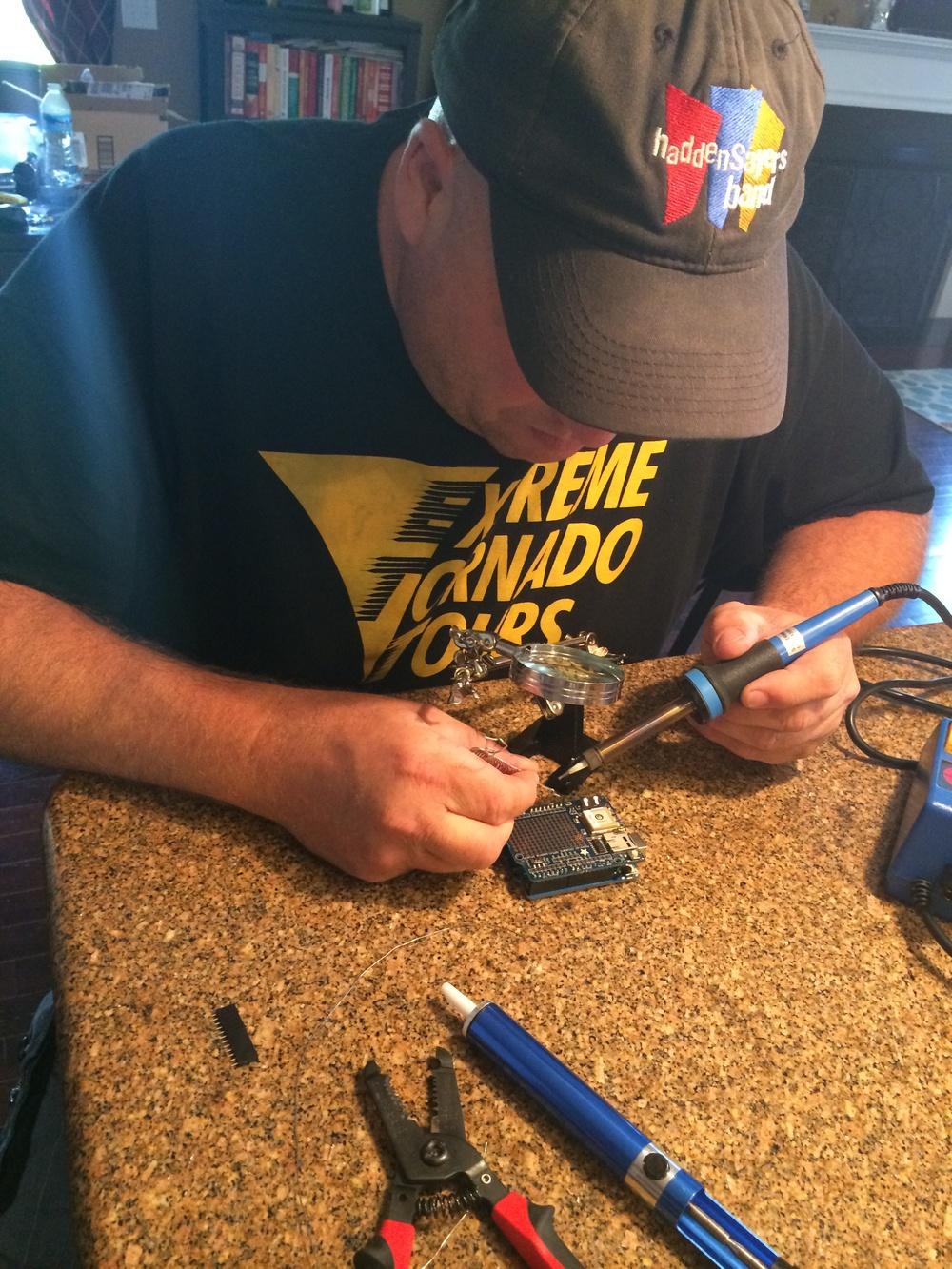 Kevin Barton soldering an Arduino Uno based tornado probe prototype
