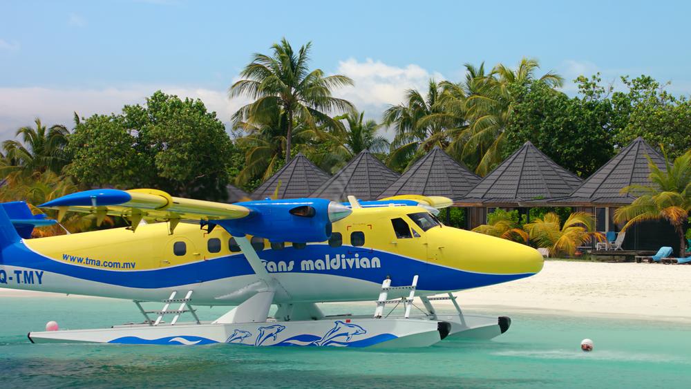 Twin Otter seaplane preparing to dock in the Maldives.