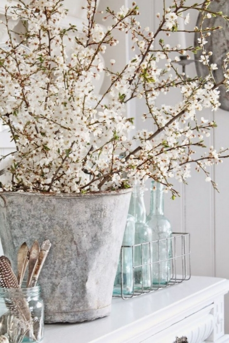 vintage zinc bucket filled with white cherry blossom