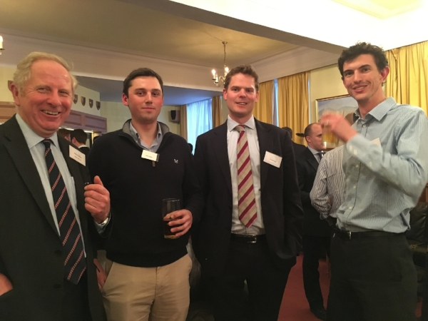 Ian Gibbs (left) with some Service leavers networking at the event.