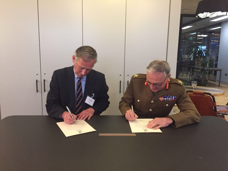 Andrew Jackson, Managing Director of SaluteMyJob and Lt General Richard Nugee CVO CBE, Chief of Defence People, signing SaluteMyJob's Armed Forces Covenant pledge.