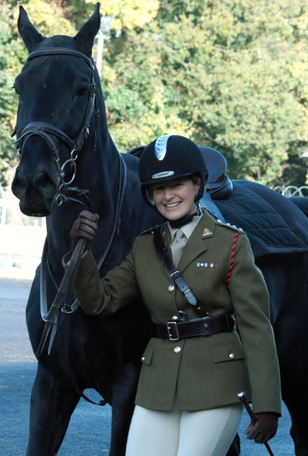 Laura competing at the Honourable Artillery Company International Uniformed Services Showjumping Competition.