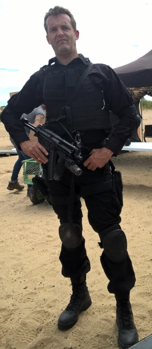 Carl playing an armed response police officer