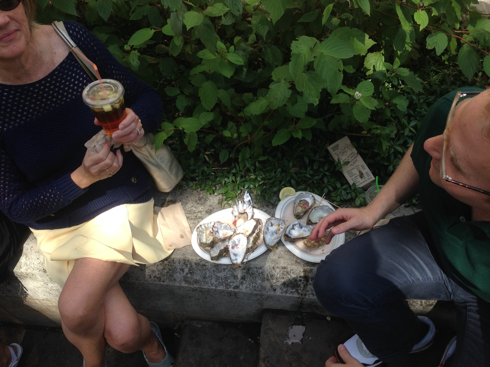 Husband and mother and discarded half shells at Borough Market, Bastille Day, 2014.