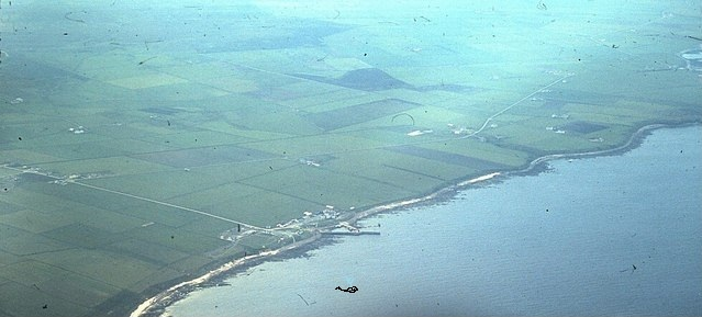 Aerial photograph of John O'Groats by Stanley Howe (from geograph.org.uk), via  Wikimedia Commons . Note the charming spouting whale offshore :)