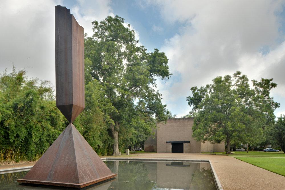 Barnett Newman's Broken Obelisk in front of Rothko Chapel in Houston, Texas. Photograph by Ed Uthmanvia (CC).
