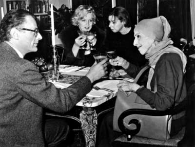 Karen Blixen, Carson McCullers, Arthur Miller, and Marilyn Monroe having lunch. NO BIGGIE.