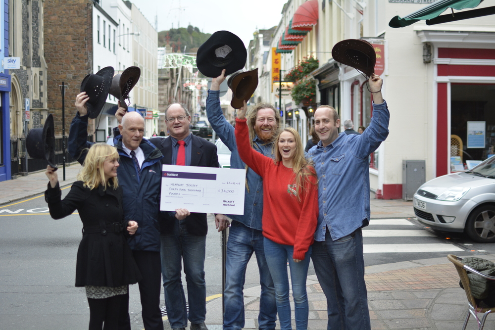 Pictured left to right: 2015 - Louise Stirling (Halkett Hoedown) Phil Sturgess, (Chairman of Headway Jersey) Simon Crowcroft (Contable of St Helier) Niall MacFirbhisigh (Halkett Hoedown/Stoked Music) Frankie Davies (Singer Songwriter & Performer at the Hoedown) David Stokes ( Halkett Hoedown/Bean Around The World - Winner - Pride of Jersey Community Champion).  Read more here - http://www.gallery.je/hoedown-raises-34000