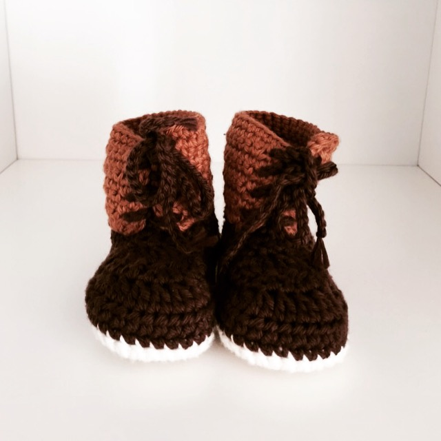 knit baby bean boots, now displayed in the nursery