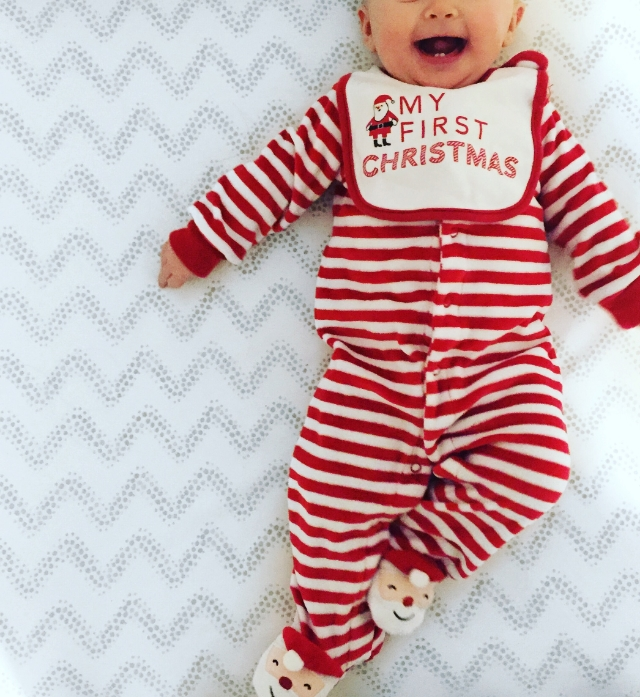 {Love this perfectly cheesy onesie- I plan on giving her a pair of Christmas pjs each year}