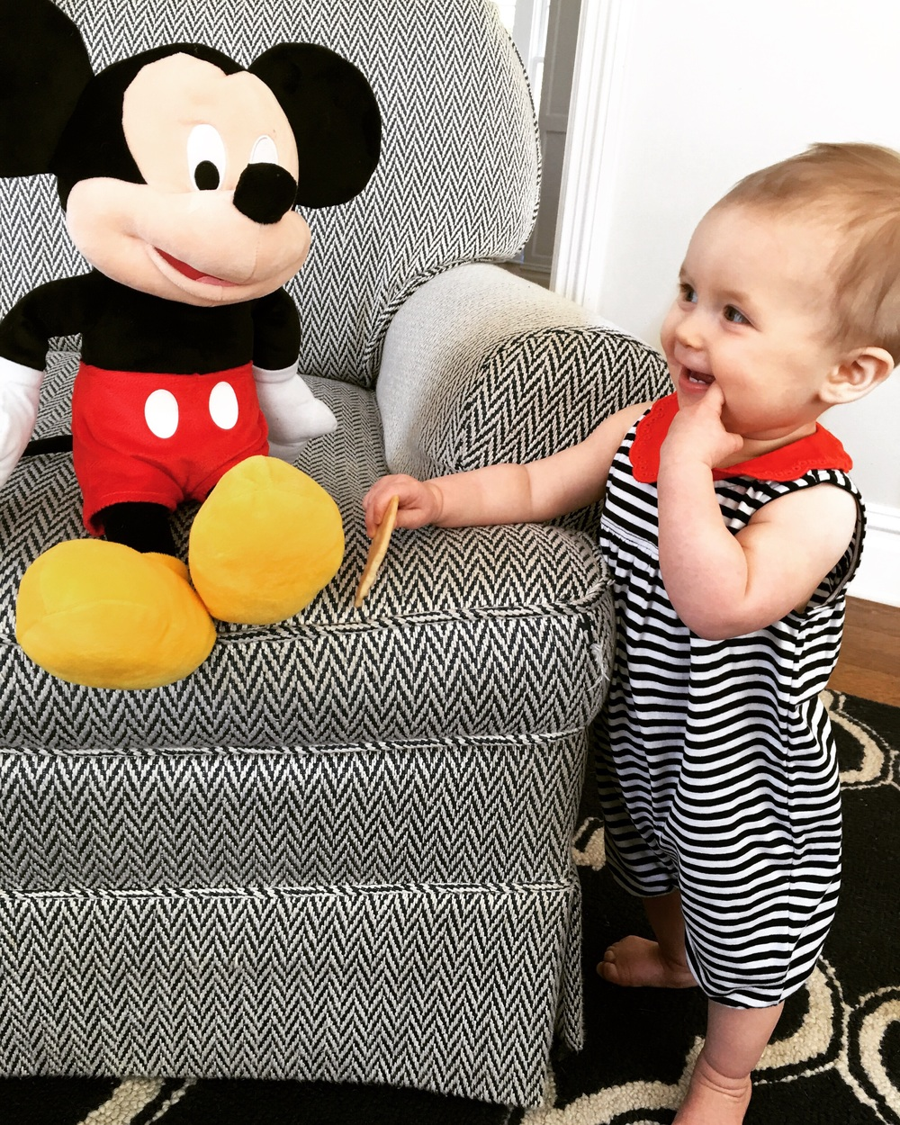 This little eleven month old + her pal, Mickey