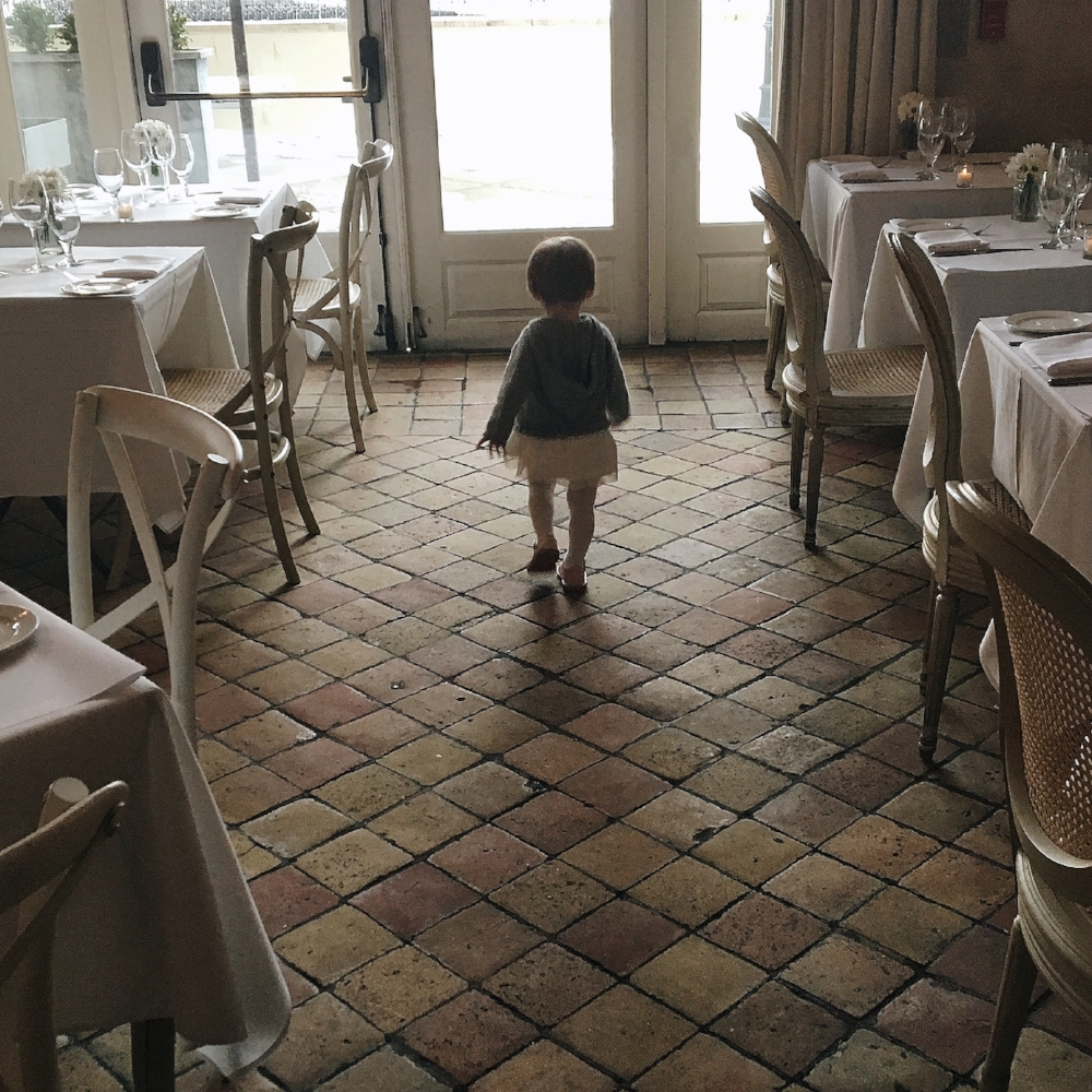 {A tutu-clad girl at one of our favorite local restaurants, L'Escale}