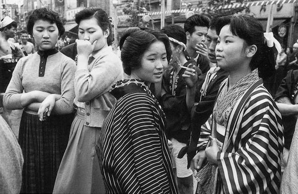 Takeyoshi Tanuma.Modern dress versus traditional dress at the Sanja Matsuri Festival. Asakusa, Tokyo, 1955.