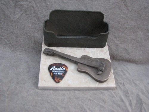 4 x 4 business card holder with acoustic guitar pick on marble