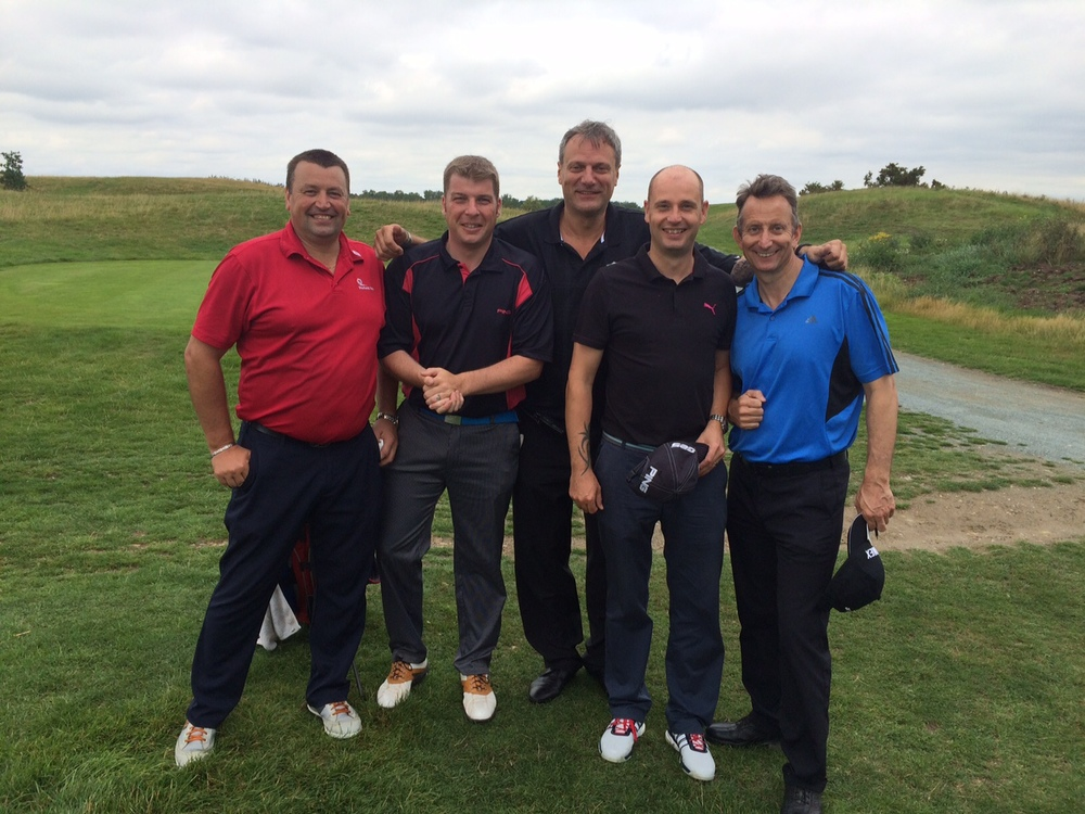 A very happy team with here pictured with Lance Haggith (centre) founder of Sports Traider UK and Golf Aid UK.